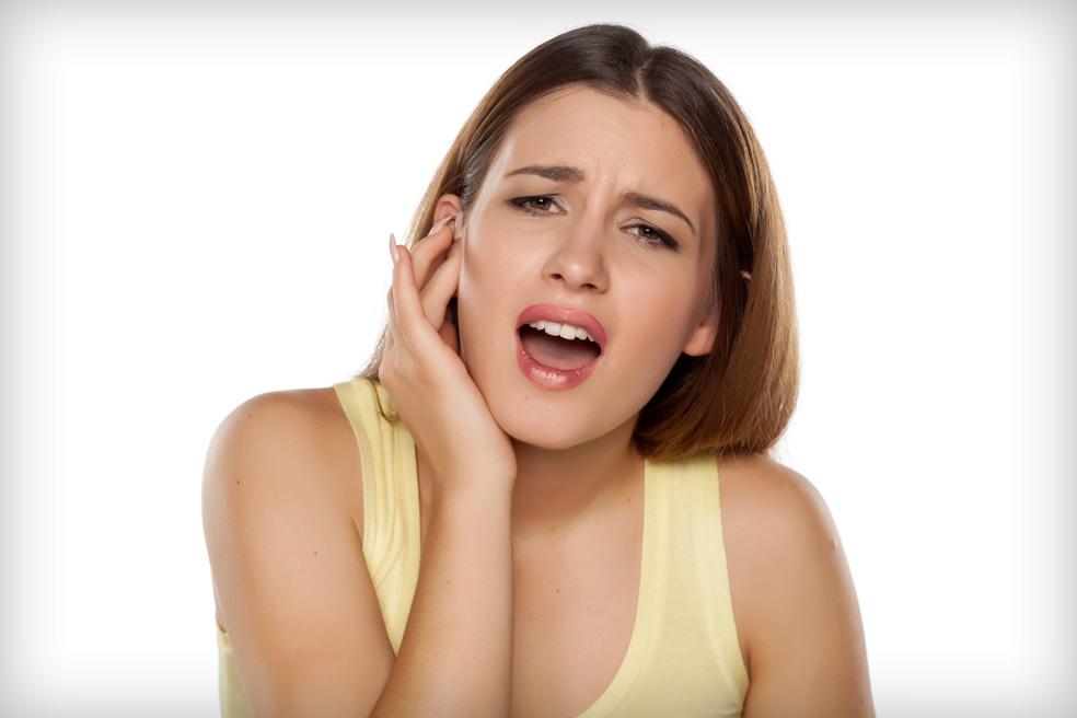 ízületi fájdalom a száj megnyitásakor)